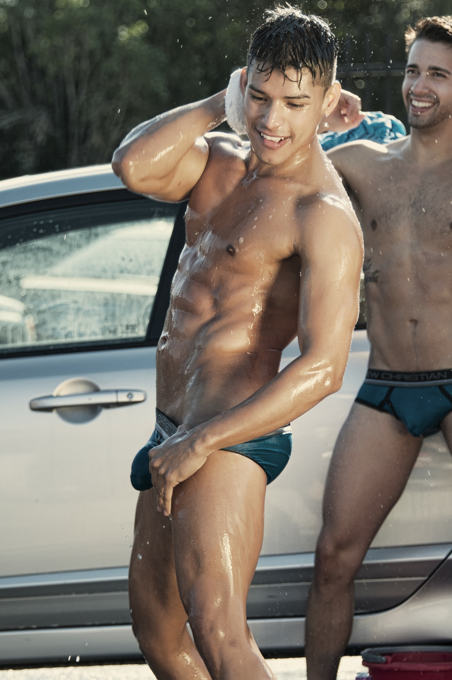 Young guys washing a car